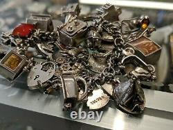 Vintage Sterling Silver 35Charms, bank of london check book Indian house Bracelet